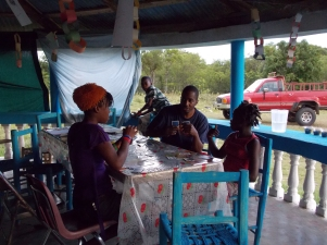 The Haitian girls teaching one of our leaders a card game