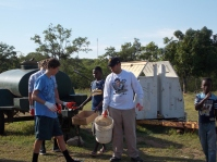 One of our leaders with our students and the orphans clearing the land for the soccer field to be built