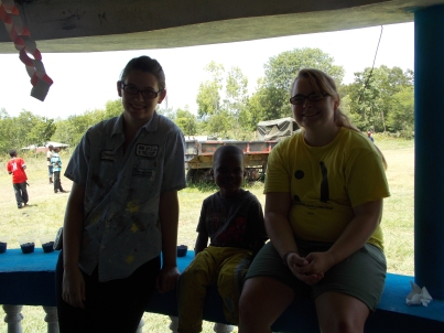 Two of our students hanging out with and getting to know one of the orphan boys