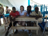 One of our teams that built this table / bench they are sitting on, two of our students worked alongside two of the Haitians