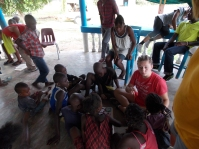 One of our students playing a game with the kids after a bible lesson