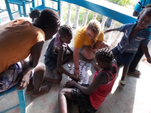One of our students playing a game with the local kids that followed a bible lesson