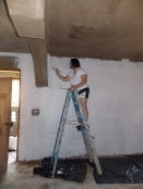 One of our students working hard to paint the kitchen / dining hall