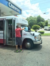 Youth Leader, Brad Walls, cleaning the windshield while traveling