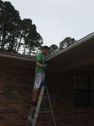 cleaning out gutters