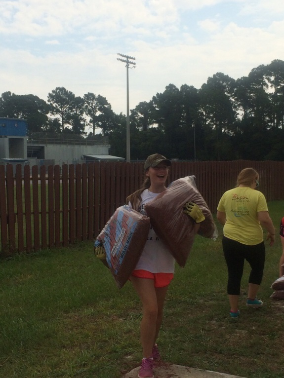 carrying mulch to garden