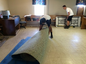 Measuring and cutting the new carpet