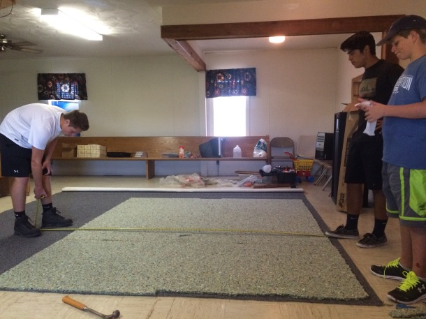 Measuring and cutting new carpet