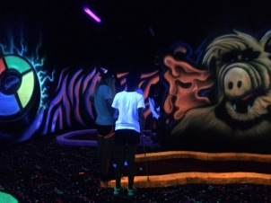 Indoor glow in the dark mini golf